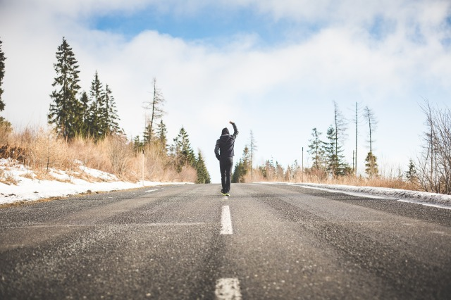 s_man-in-a-winner-pose-walking-on-the-road-picjumbo-com